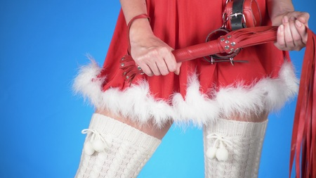 seductive santa girl with sex toys in seductive poses. on a blue background. a close-up. Kho ảnh