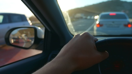 first-person view. Driving a car in rush hour Фото со стока