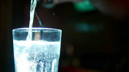 close up of bartender making a cocktail