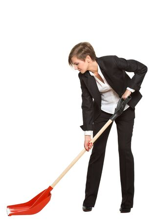 allegory. office worker, manager, tortured business woman with a shovel on a white background Stockfoto