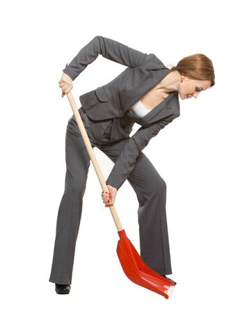 red-haired woman in a suit, office worker, manager, with a shovel. isolated on a white background. allegory. Stockfoto