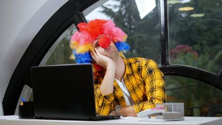 allegory concept, office worker. Clown manager in the office