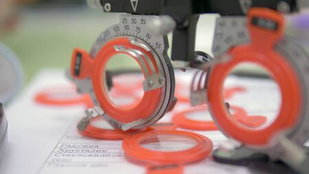 The concept of ophthalmology. A set of test lenses for checking visual acuity in a special frame.