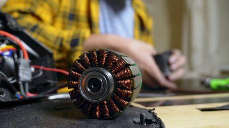 mechanic repairing an electric motor of an electric skate. bearing close up.