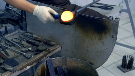 glassblower. craft manufacturing of glass products
