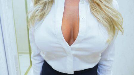 closeup of neckline unrecognizable beautiful girl blonde in the white blouse.
