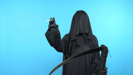Sketch on a blue background. death with a scythe shows a cigarette