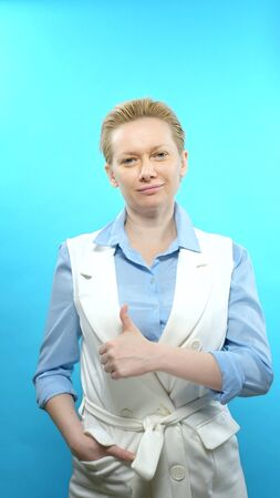 vertical shot. blonde woman without makeup on a blue background. sign super Stok Fotoğraf