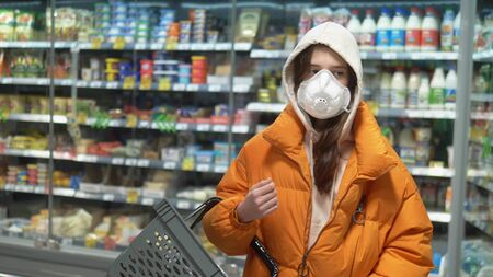 brunette girl in medical mask at the grocery store. pandemic