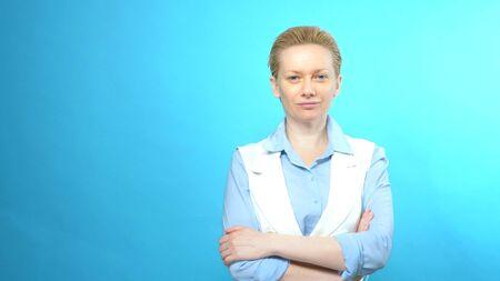 portrait of blonde woman without makeup on a blue background. copy space Zdjęcie Seryjne
