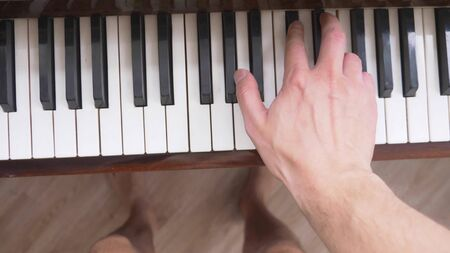 closeup. male hands playing the piano. copy space.