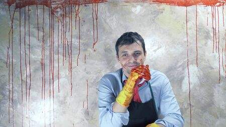 the man in the tie stained with blood on the bloody wall background.