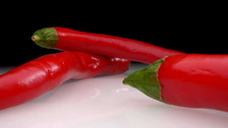 extreme close-up. detailed. hot red pepper on a dark background Фото со стока