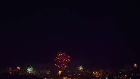 many flashes of fireworks over the night city. general holiday