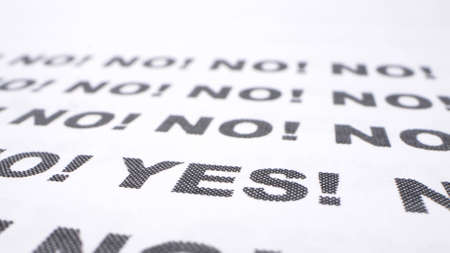 text background. close-up. typing the word yes with an exclamation mark