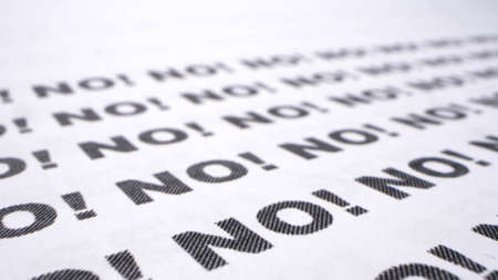 text background. the word no written many times on a white piece of paper