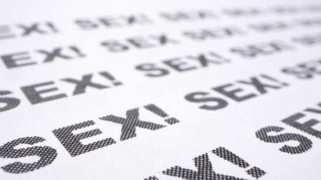 extremely close-up, detailed. the word sex written many times on a white piece of paper