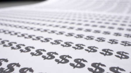 extremely close-up, detailed. text background. dollar sign printed on paper Фото со стока