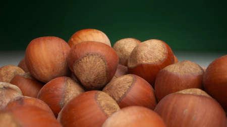 extremely close-up, detailed. many hazelnuts on a dark background