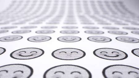 background from smiles. icons with smiling faces on a sheet of paper. close-up