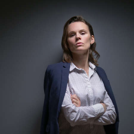 a woman in a suit looks at the camera and says no. body language