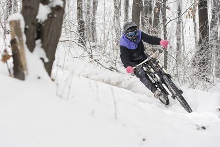 Mountainbiker riding on snow in winter