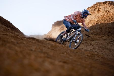 Mountainbiker rides in gorge on desert photo