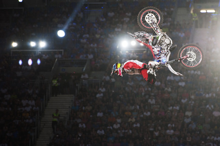POZNAN; POLAND - AUGUST 6: A professional rider at the FMX Freestyle Motocross competition at Red Bull X-Fighters, 2011.