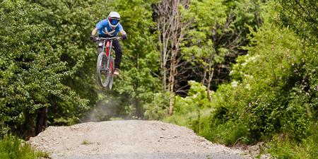 Professional athlete high jump on a mountain bike. Stock Photo
