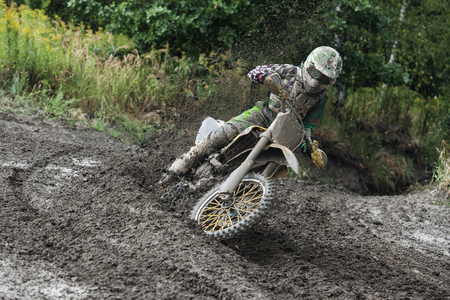 powerfull: Rider driving in the motocross race