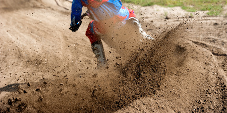 powerfull: Motocross rider creates a large cloud of dust and debris