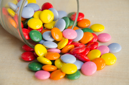 sugarcoated: Colorful sugar-coated chocolate smarties in a glass Stock Photo