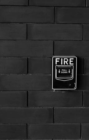 fire brick: fire alarm on brick wall Stock Photo