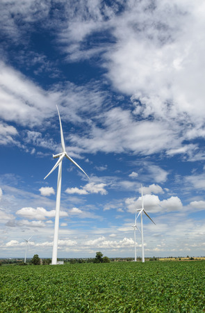 produce energy: Wind turbines produce electricity Alternative energy with sky and cloud background Stock Photo