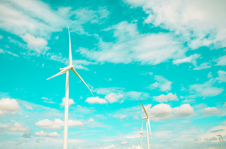 windfarms: Wind turbines produce electricity Alternative energy with sky and cloud background Stock Photo