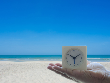 vocation: The clock on the hand with topical beach Concept Time to Vocation and Holiday