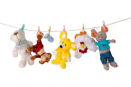 juguetes: Juguetes de color sobre cable Foto de archivo