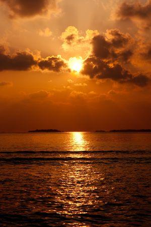 beatitude: Sunrise at ocean. Maldives. Stock Photo