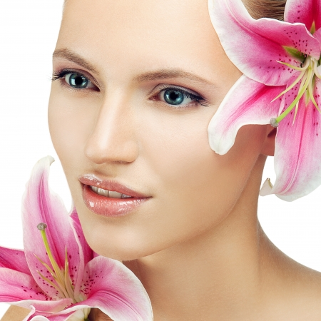 pink lips: beautiful woman with a flower Stock Photo