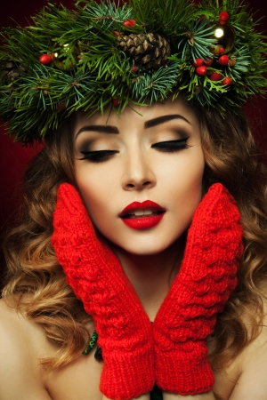 Christmas Woman  Beautiful Christmas wreath  New Year  photo