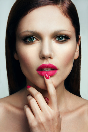 matte: Portrait of beautiful girl with pink lips and blue eyes Stock Photo