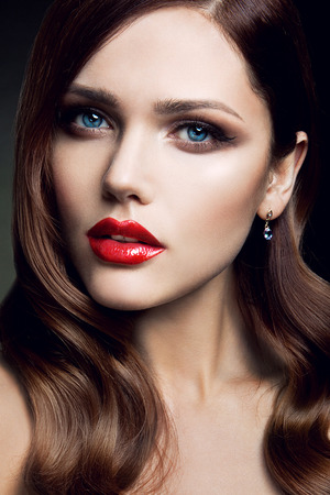 matte: Portrait of beautiful girl with red lips and blue eyes