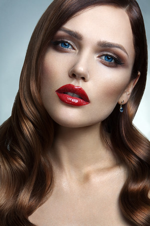 Portrait of beautiful girl with red lips and blue eyes photo