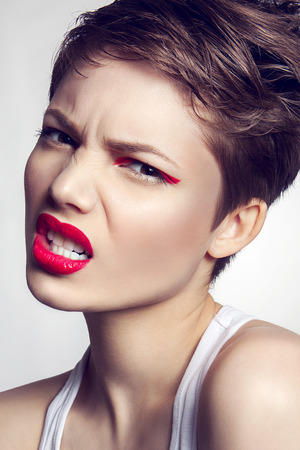black hairs: Portrait of beautiful girl with red lips and short hair