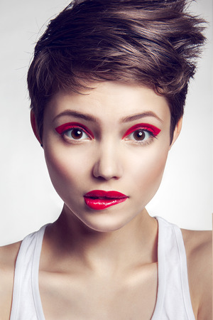 Portrait of beautiful girl with red lips and short hair photo