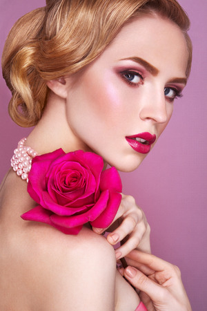 perl: Lady with pink rose  Stock Photo