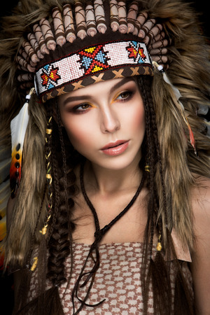indian headdress: Beautiful ethnic lady with roach on her head. Indian