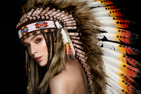 Beautiful ethnic lady with roach on her head. Indian photo