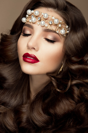 red lips: Beautiful young model with red lips and curly hair