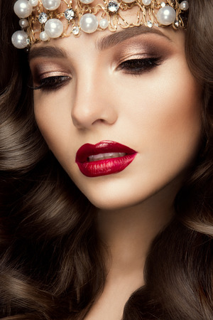 make up eyes: Beautiful young model with red lips and curly hair
